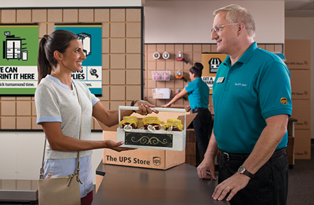 woman being helped by man at UPS