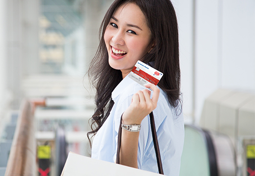 woman with AAA visa credit card
