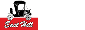 East Hill Logo on red background featuring a black old fashioned car