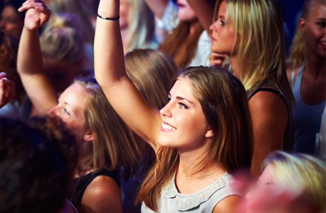 group enjoying concert focus on one woman