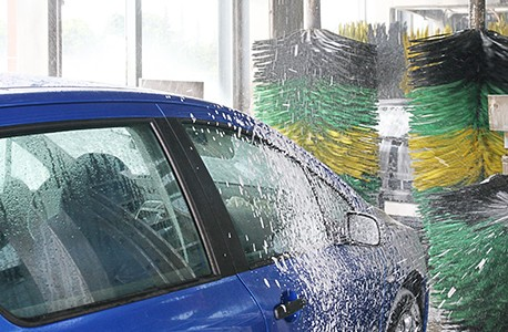 blue car in automated car wash