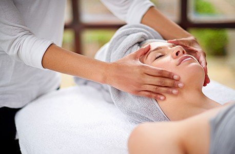 Woman relaxing spa facial