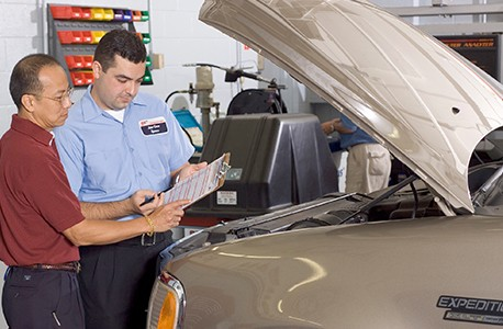 AAA Approved Auto Repair tech explaining a repair to a AAA member