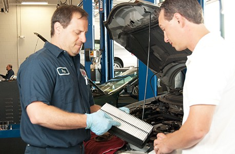 AAA Car Care Plus Mechanic reviewing a repair with a AAA member