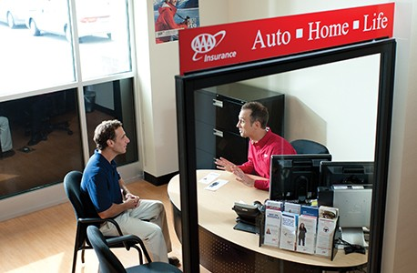 AAA Insurance Agent providing an insurance quote to a AAA member