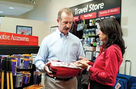 AAA Member purchasing a vehicle safety kit from the AAA Travel Store with the help of a AAA associate