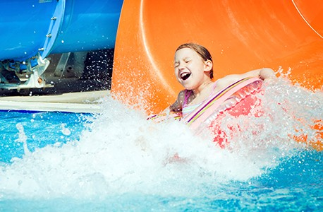 Young girl coming out of a waterslide