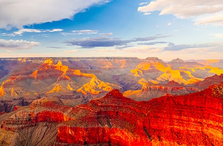 A landscap photo of the American West featuring red and yellow colors