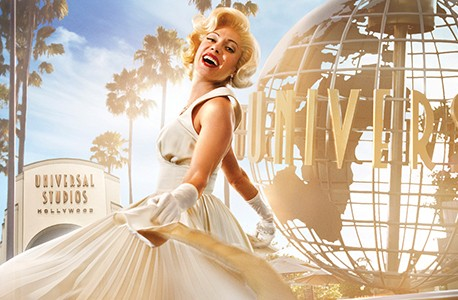 Marilyn Monroe look-a-like twirling in front of the Universal Studios front gate and globe