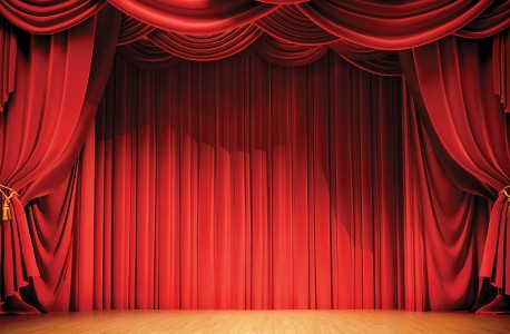 An empty stage with red curtains