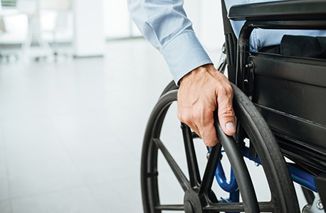 A close up of an individual using a wheelchair