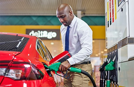 Businessman pumping fuel at Shell
