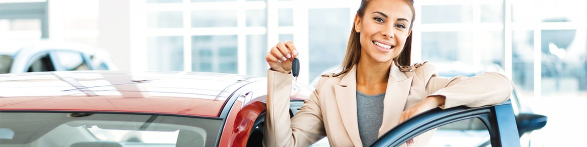 WOMAN BUYING NEW CAR SHOWING OFF KEYS