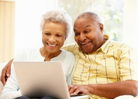 Couple checking online savings, money markets, CDs and IRAs